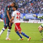 Bayern Munich's Jerome Boateng and Hamburg SV's Kerem Demirbay (C) argue as Bayern Munich goalkeeper Manuel Neuer (R) comes up during their German Bundesliga first division soccer match in Hamburg May 3, 2014. REUTERS/Morris Mac Matzen  (GERMANY - Tags: SPORT SOCCER TPX IMAGES OF THE DAY) DFL RULES TO LIMIT THE ONLINE USAGE DURING MATCH TIME TO 15 PICTURES PER GAME. IMAGE SEQUENCES TO SIMULATE VIDEO IS NOT ALLOWED AT ANY TIME. FOR FURTHER QUERIES PLEASE CONTACT DFL DIRECTLY AT + 49 69 650050